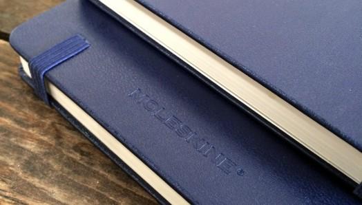 Navy Moleskine notebook brand