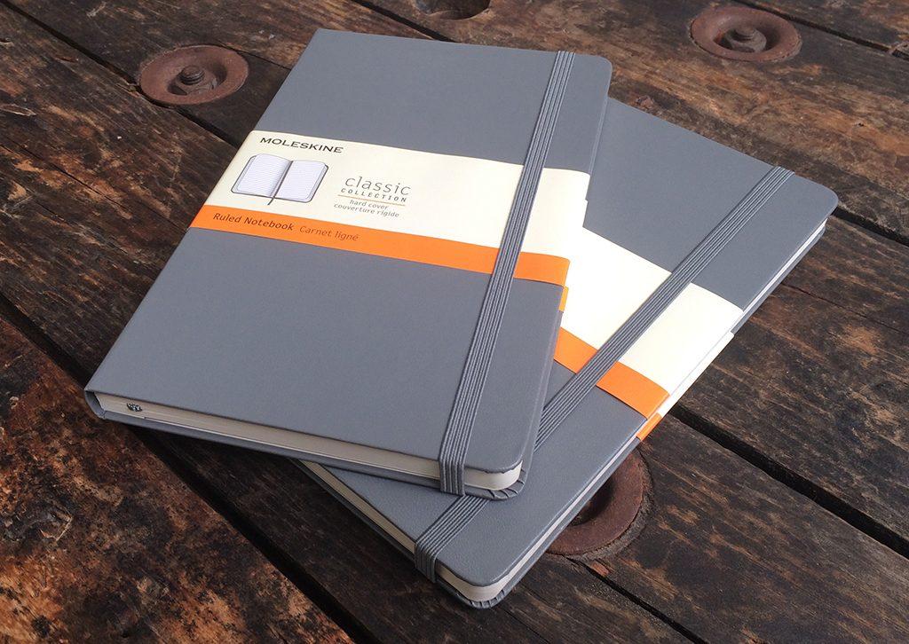 grey Moleskine notebooks