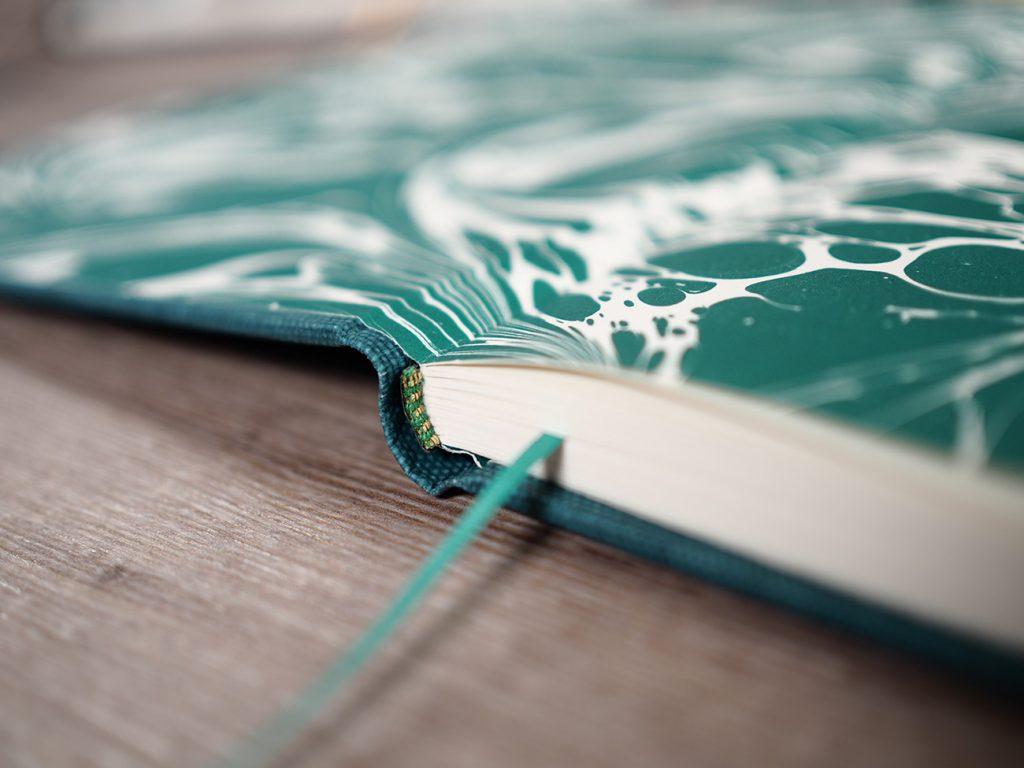 Handmade-notebook-with-gold-green-headbands