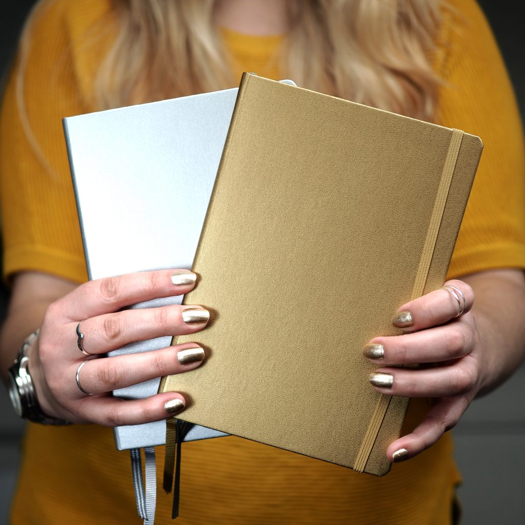Silver and gold metallic notebooks