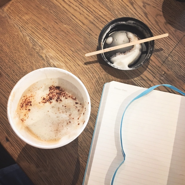 Notebook and coffee stay focused in cafes
