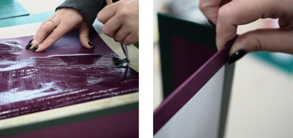 Purple paper is glued to the lining of the box for Headley Court's leather journal
