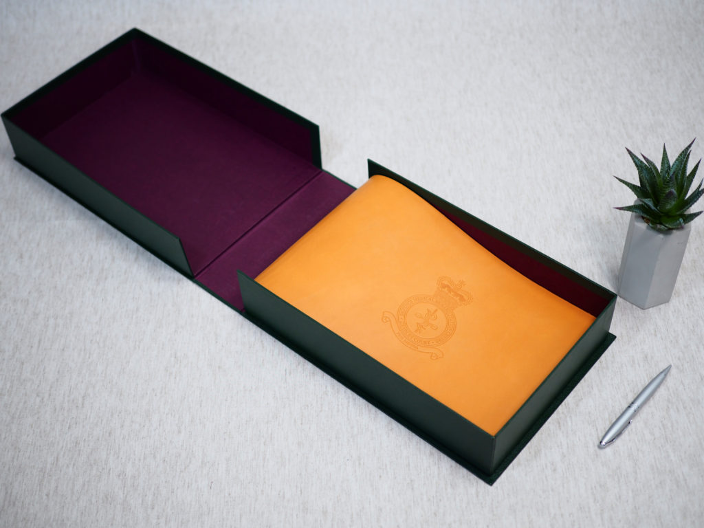 Finished clamshell presentation box holding the bespoke leather journal for Headley Court.