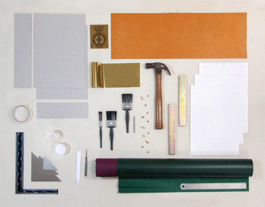 The materials that went into the Headley Court leather journal and box neatly laid out