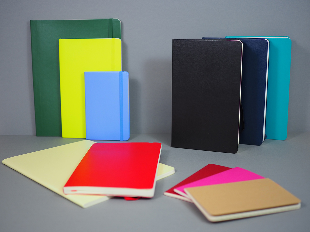 Various Moleskine notebooks in different colours and different sizes.