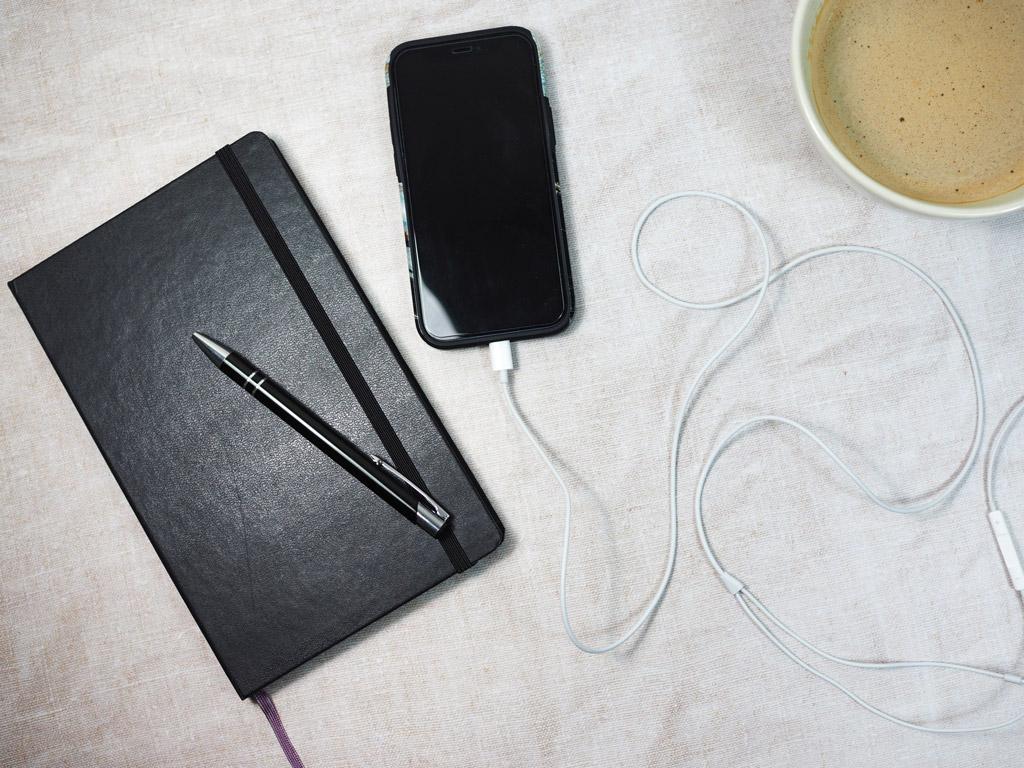 Moleskine journal with coffee